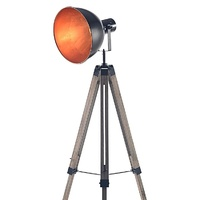 Industrial tripod floor lamp with black and copper spotlight shade